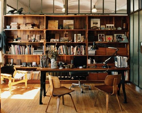 Because wooden shelves and lots of books just go together.