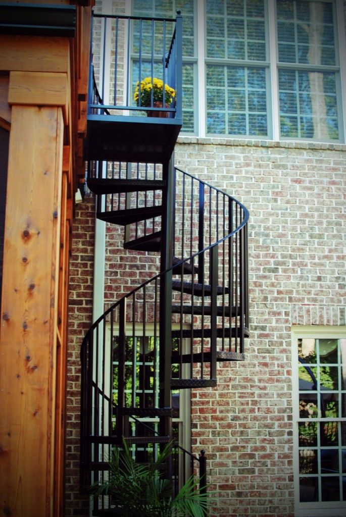 Exterior:Exterior Charming Desk With Stair Decoration For Outdoor Living Space Design Ideas With Spiral Black Iron Stair Case And Brick Wall...