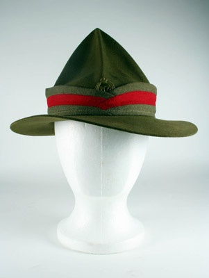 NZ Army Slouch Hat    A khaki felt lemon squeezer shaped slouch hat with khaki fabric band with red strip around centre. Inside hat each quarter is printed with 'Far East', 'Malaya', 'NZ 13488' and 'Sailor'.    Generally associated with the Australian military the slouch hat also referred to as a lemon squeezer was first worn by the New Zealand Army in the early 1900s. It was removed from army uniform by the late 1950s, but was returned in 2000 to be worn as part of ceremonial service dress.