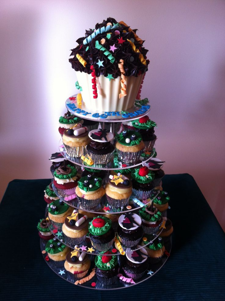 Cupcake Tower incl. Giant Cupcake with Confetti & Ribbons and Themed Cupcakes: AFL Sherrin Footballs, Ten Pin Bowling, Quoits, Lawn Bowls & Ballroom Dancers • by Baking Gorgeous | www.bakinggorgeous.com