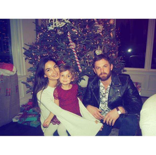 "Stars celebrating Christmas 2016:    ""Wishing Everyone a Very Merry Christmas Eve ❤"" ‐‐Lily Aldridge, who posted this photo on Instagram with her husband Caleb Followill and their daughter Dixie Pearl on Dec. 24"