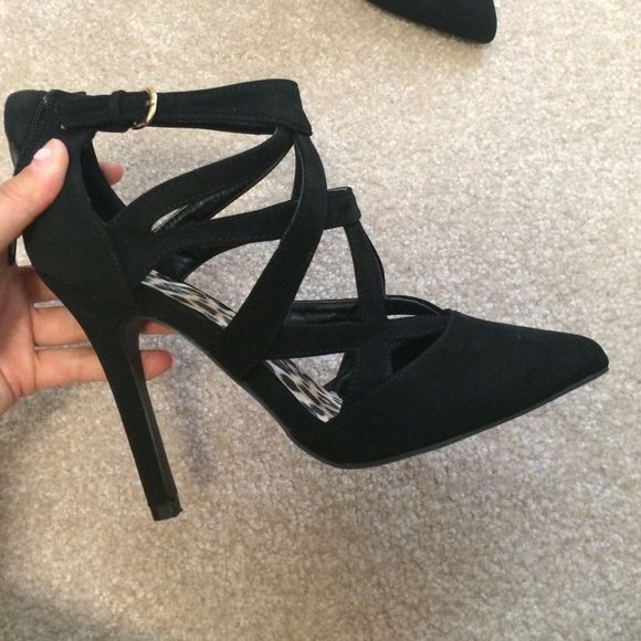 Black strappy closed toed heels 3.5 inch heels. Only worn twice Shoes Heels