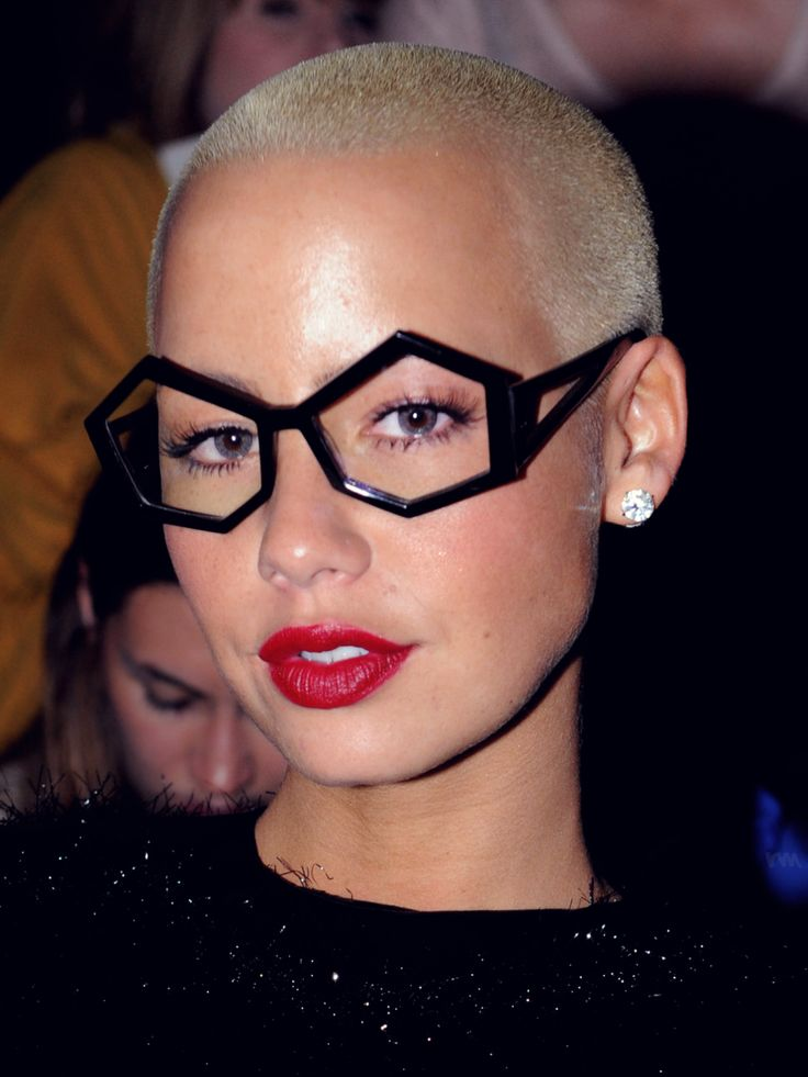 Amber Rose brings a feminine touch to her blond shaved head