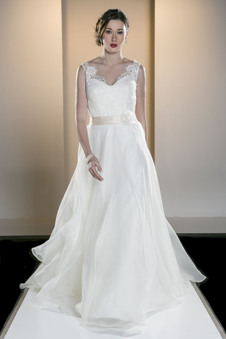 OCA 552T 'Gemma' A V-neck Chantilly style lace bodice with sheer shoulder detail and a full organza skirt.