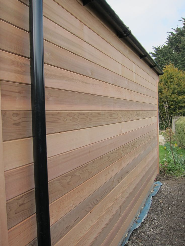 Western Red Cedar is a beautiful natural cladding option offered by Executive Garden Rooms.