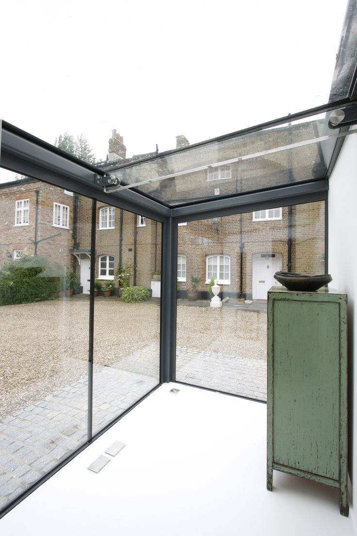 Glass box extension to home in Esher with grey backpainted bands and a glass beam to the roof http://iqglassrooms.com/h/projects/homefarmclose/429/