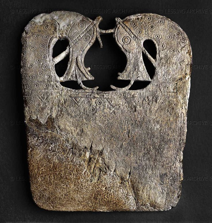 "Whalebone plaque, Viking, 9th century. Whalebone plaque decorated with a pair of openwork horses' heads at the top and incised with ring-and-dot and geometric designs. Often believed to be ""ironing boards"", these plaques are now rather interpretated as intended for serving food.  This example is from a barrow burial at Lilleberge, Namdalen, Norway. Whales were hunted for their skins, meat and whalebone; they also sometimes stranded themselves or were washed ashore"