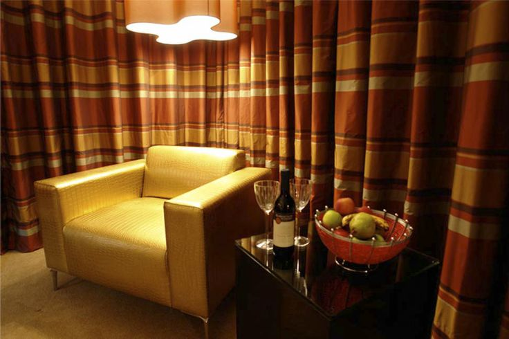 Luxury Lounge - Orange: These suites have large floor to ceiling windows overlooking the rolling landscape of the Klipriviersberg; they are located in the bush area of Thaba Ya Batswana ensuring quiet privacy. Each air-conditioned suite is equipped with large screen LCD television, and iPod docking station.