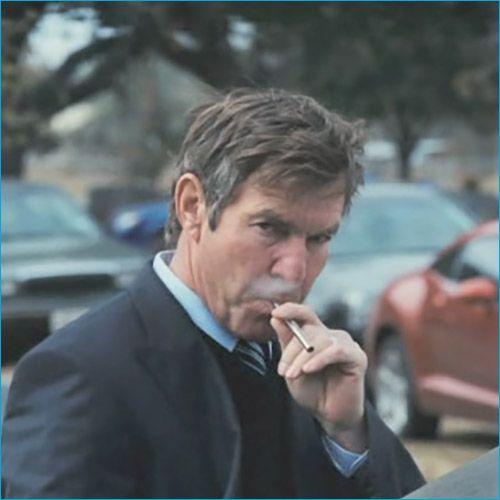 Dennis Quaid vaping a sleek, silver e-cig. Get yours today at deluxecig.com