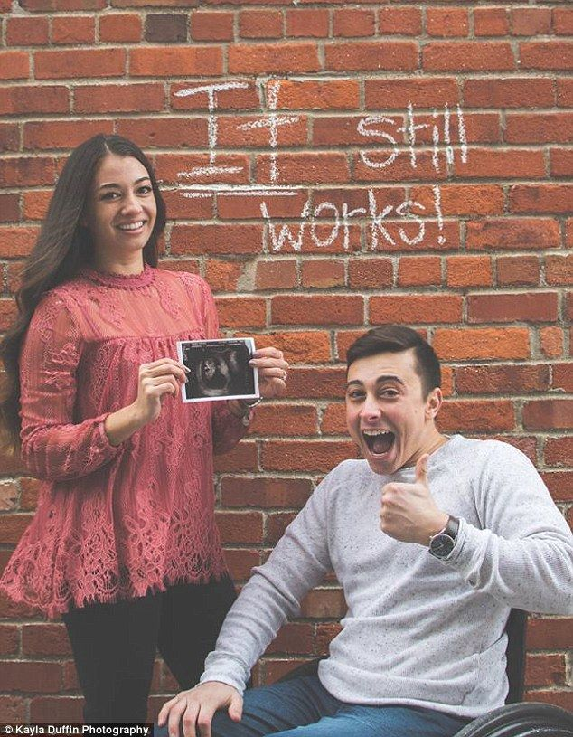 Cheeky: The comical image taken by photographer Kayla Duffin sees Todd giving a thumbs up in his wheelchair while posed in front of a brick wall that has 'It still works!' written in chalk