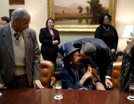 President Obama leans over to kiss Dr. Dorothy Height, the godmother of the civil rights movement. Dr. Dorothy Height, who devoted her life to those struggling for equality.