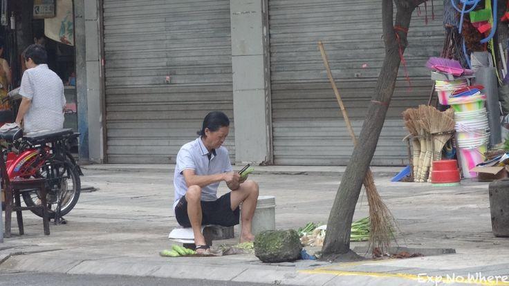 Peeling vegetable in Chengdu, China