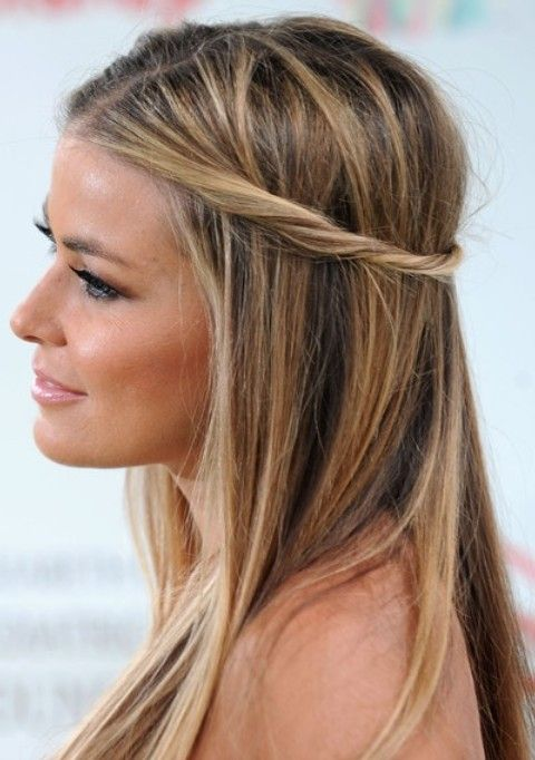 Carmen Electra shows us an easiest way to wear a half-up half-down hairstyle. Part your hair from the center and take two stands of hair from each side in the front. Twist them, and then put them together. You get this stylish hairstyle effortlessly.