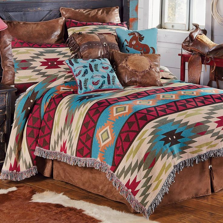Woven with a classic kilim design in a vintage palette of blues, reds and greens, the cotton/poly Southwest Expressions Tapestry Bedding Collection creates an inviting southwest space.