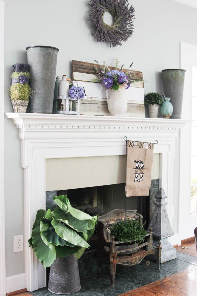 Summer Mantel decorating with reclaimed wood, galvanized buckets and burlap sign inside a rustic, vintage heater