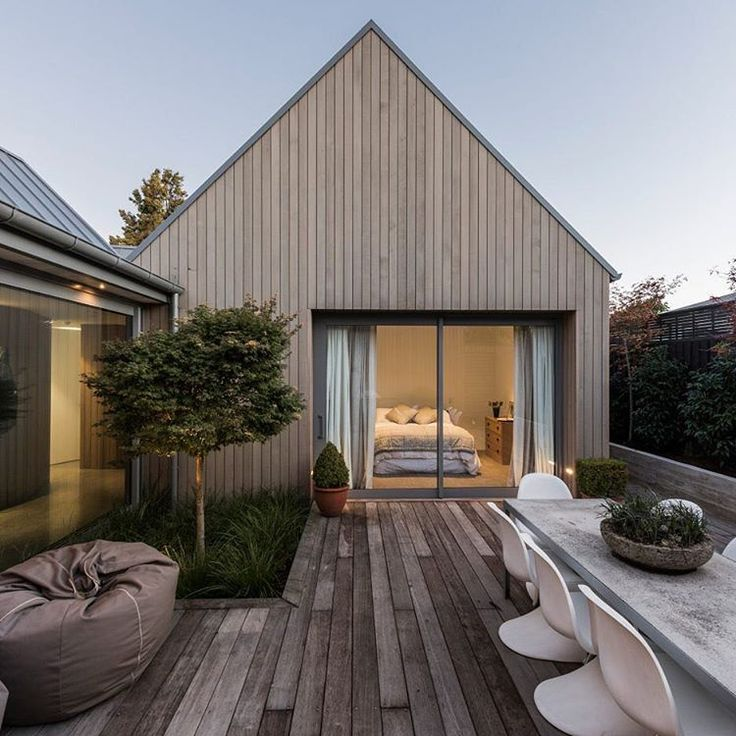 House-shaped Blocks And Courtyards Make Up This Cedar-clad