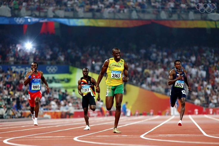 BEIJING - AUGUST 20: Usain Bolt of Jamaica competes on his way to breaking the world record with a time of 19.30 to win the gold medal in the Men's 200m Final ahead of Churandy Martina of Netherlands Antilles, Brian Dzingai of Zimbabwe and Shawn Crawford of the United States at the National Stadium during Day 12 of the Beijing 2008 Olympic Games on August 20, 2008 in Beijing, China. (Photo by Michael Steele/Getty Images)