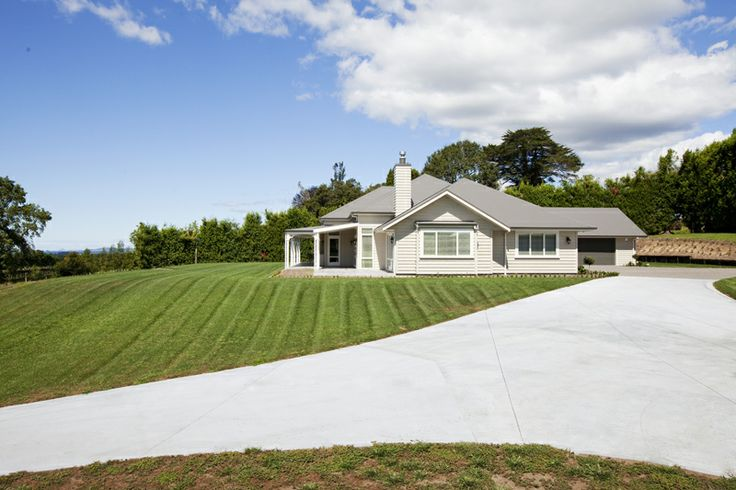 From a farming background to a kiwifruit lifestyle block, it took the clearing of tall shelter trees and considerable earthworks for the owners to create the obvious - a sweeping site with full command on views across the lowland out to sea.