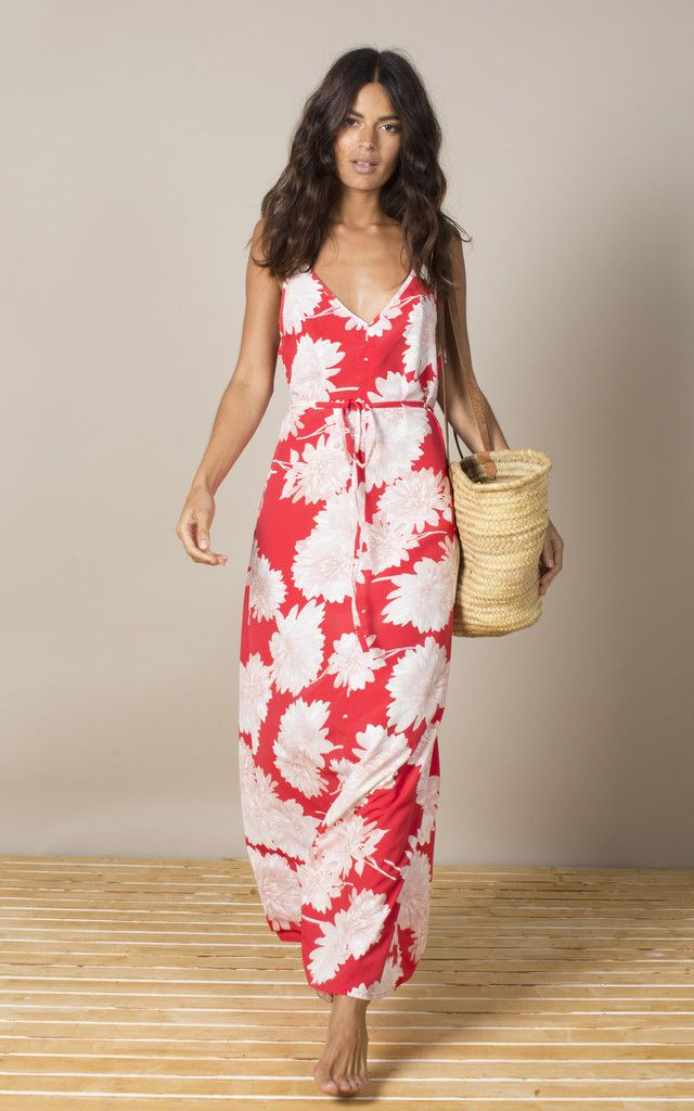 Gorgeous red maxi dress with oversize floral print. Features a tie waist and low back. Team with sandals on a sunny day or throw a leather jacket over it for an evening look. Pretty and boho, this dress will set you up for the summer! Shop now.