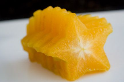 Cutting a starfruit-Yellow is ripe and sweet. The green are tart and not as good.