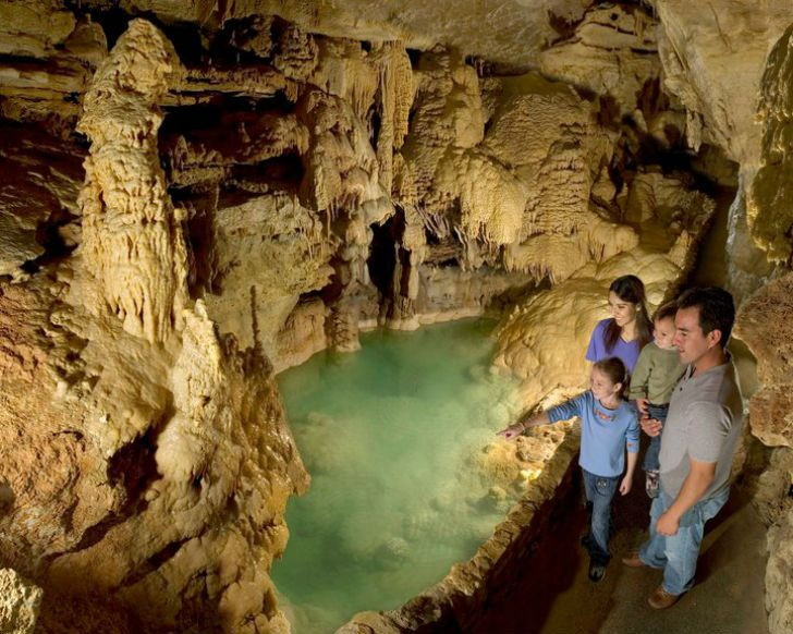25 Places Every San Antonian Should Take an Out of Towner: Natural Bridge Caverns. Halfway between San Antonio and New Braunfels, Natural Bridge Caverns is the largest commercial cave in Texas. It's so expansive, in fact, that exploration of the cave still continues. The attraction offers a variety of tours, and the adjacent Natural Bridge Wildlife Ranch is home to zebras, bison, gibbons and giraffes. Think of all the Kodak moments.