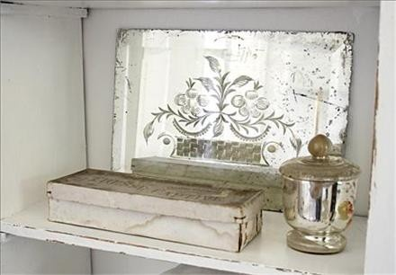 Elegant and aged to perfection.  maybe pur mirror behind etched glass frame and put over fireplace