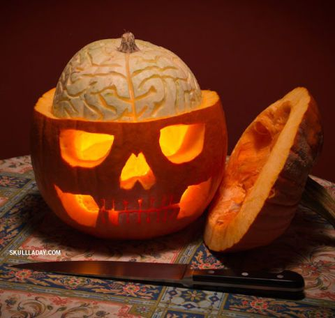 Two pumpkins—one small white, one larger orange—are the secret behind this head-splitting look. Get the tutorial at Skull-A-Day.