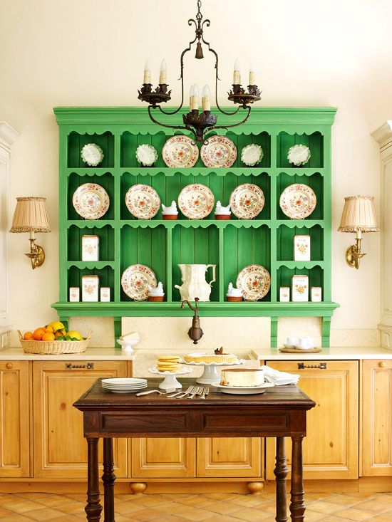 Change It Up - Neutrals are a safe bet in the kitchen, but a touch of color adds personality. A wall hutch painted an energetic mint green displays vintage pottery and dishes. A quick paint job on the hutch can change the color palette of the kitchen. Matching is not a problem, because neutral cabinets and flooring can pair with almost any color.