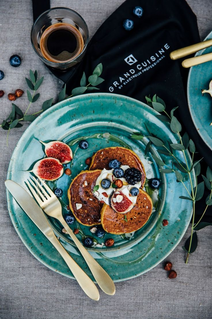 Pumpkin pancakes with coconut yogurt, hazelnuts, figs and berries: