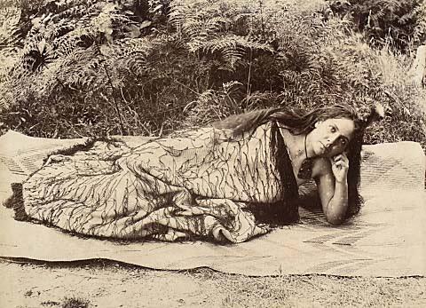 Maori woman wearing korowai cloak