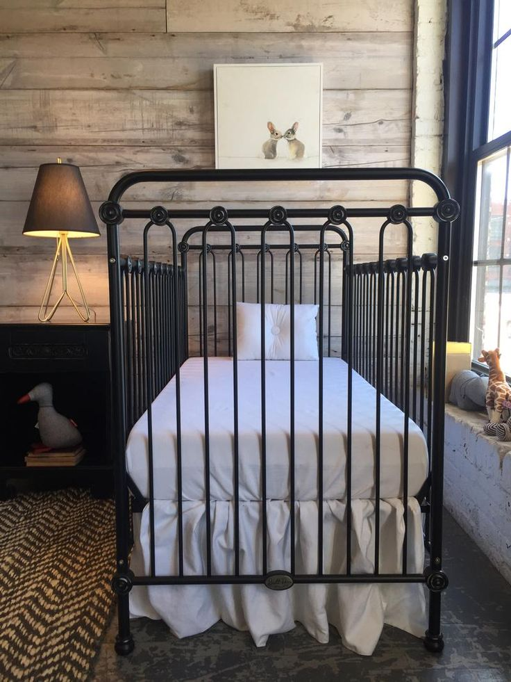 Loft Living, featuring black Joy iron crib + all white bedding.
