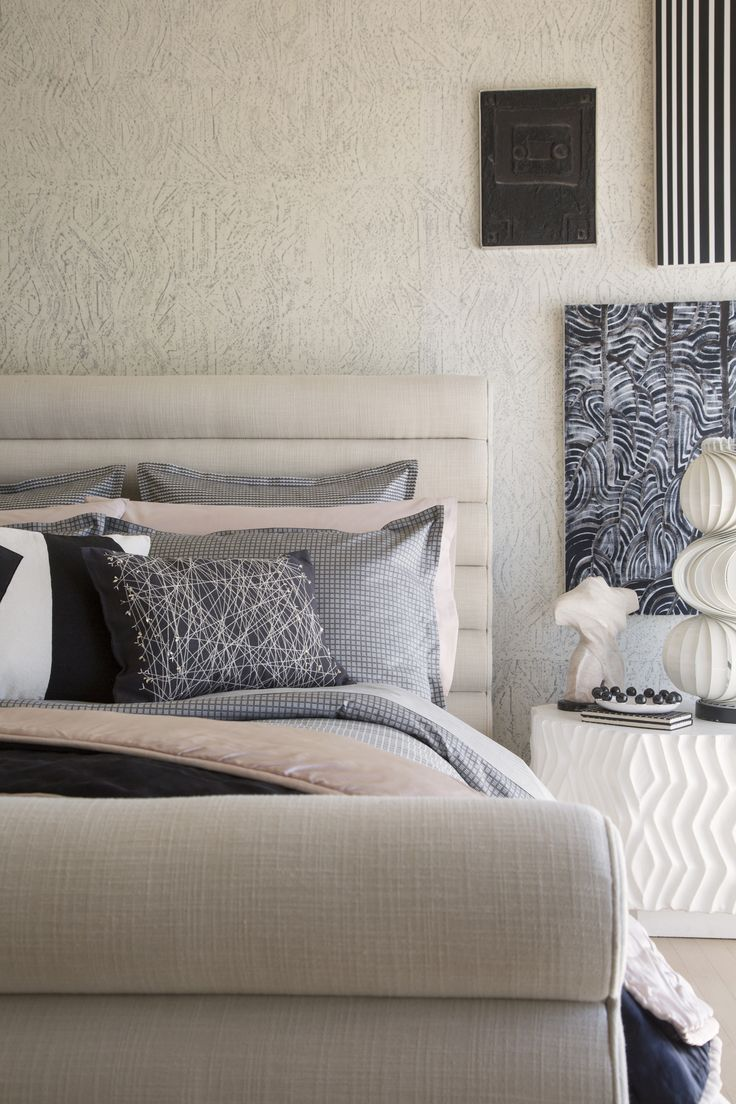 KELLY WEARSTLER | ZEPHYR BEDDING. Featuring Momento Euro Sham, Zephyr Sham in Pyrite Grey, Zephyr Pillowcase in Shell Pink, Striscia Decorative Pillow, Zephyr Duvet cover, Craze Quilt, Zephyr Flat Sheet.