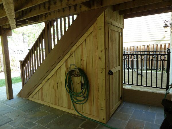 This would be perfect!! Image from http://landartdesign.com/images/sheds/jpgs/13-Arlington-Under-Stairway-Storage-Shed.jpg.