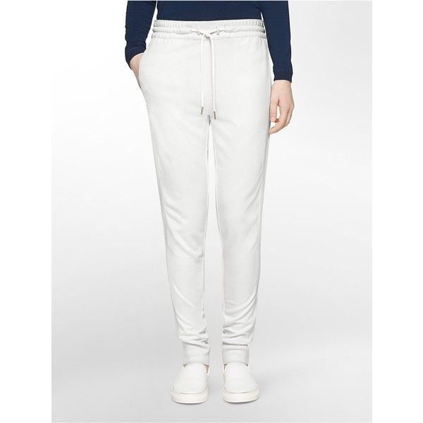Calvin Klein Women's Faux Leather Stripe Jogger Pants ($30) ❤ liked on Polyvore featuring pants, white, jogger pants, leather look pants, faux leather pants, fake leather pants and imitation leather pants