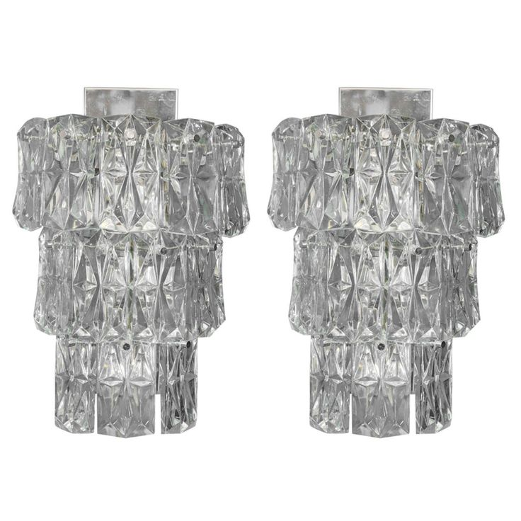 A vintage pair of large Kinkeldey three-tier sconces with clear faceted crystals and chrome mounts. These sconces take six candelabra bulbs.
