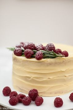 Delicate vanilla cake layers filled with mascarpone cream and raspberry compote and covered with white chocolate buttercream