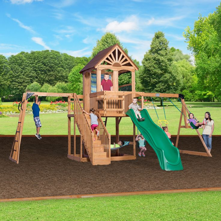 Oceanview Wooden Swing Set. An open, airy clubhouse, monkey bars, swings, a 10' wave slide, staircase, and even a hammock!