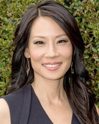 Straight black hair can look typical, so Lucy Liu spices up her style with voluminous waves and multidimensional color that come from subtle highlights.