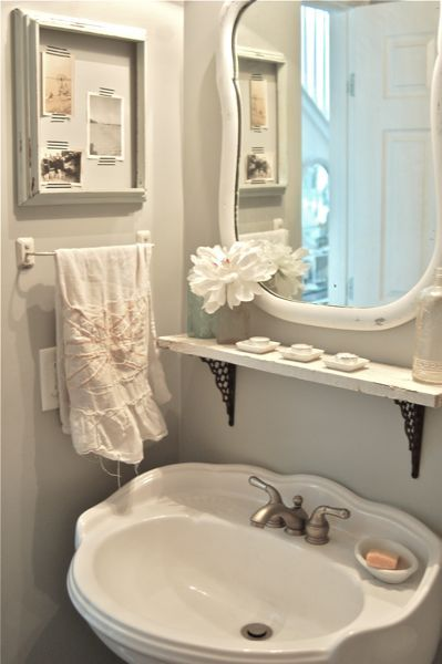 Frame old beach photos washi tape to hold them in place. Vintage Junky - Creating Character: The Powder Room~