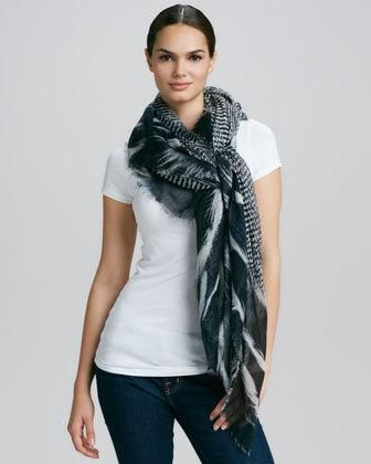 For daytime wear, try this Roberto Cavalli scarf loosely wrapped around the neck like a cowl or tied close to the neck in place of a necklace. For evening, wrap around your shoulders to add...