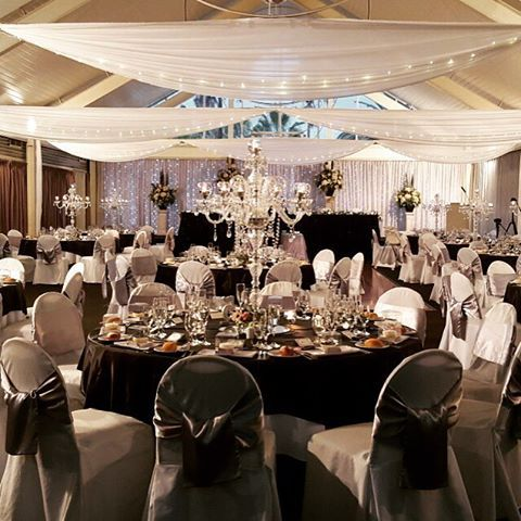 Recent wedding styled by Fairytale Events at the #1 voted reception venue in Sydney, Colebee Center. Specialty linen, candelabra's, ceiling draping, bridal table, candy buffet by Fairytale Events. #Fairytaleevents #Colebee Center #Crystalcandelabrahire #ceilingdraping #Candybuffethire #linenhire #bridaltablestyling
