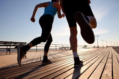 Two people running on promenade