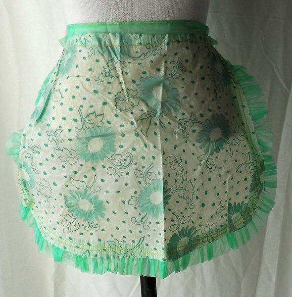 1950s Women's green flowered plastic apron
