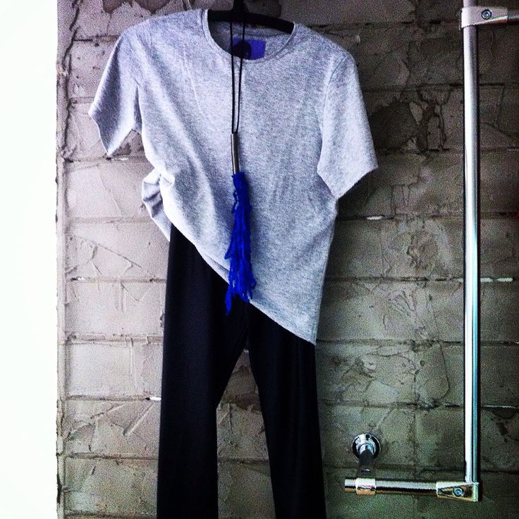 Plain grey blouse Leather leggings Spiral blue necklace