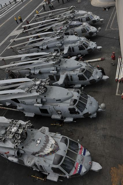 U.S. 5TH FLEET AREA OF RESPONSIBILITY (Aug. 16, 2013)- Helicopters 6 are positioned on the flight deck of the aircraft carrier USS Nimitz (CVN 68). Nimitz Strike Group is deployed to the U.S. 5th Fleet area of responsibility conducting maritime security operations, theater security cooperation efforts and support missions for Operation Enduring Freedom (U.S. Navy photo by Mass Communication Specialist Seaman Kole E. Carpenter/Released).