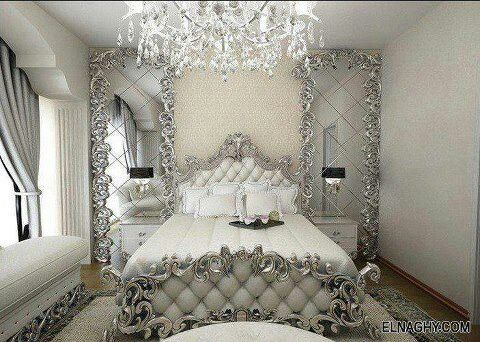 Ornate white & silver bedroom.