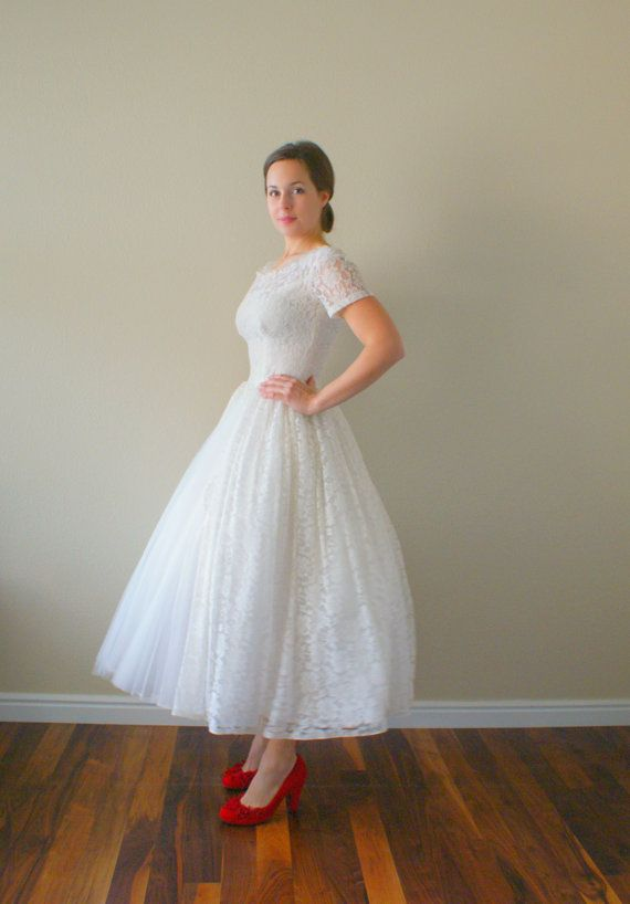 Short 50s wedding dress, with loads of beautiful lace #retro wedding ... Wedding ideas for brides, grooms, parents & planners ... https://itunes.apple.com/us/app/the-gold-wedding-planner/id498112599?ls=1=8 … plus how to organise an entire wedding, without overspending ♥ The Gold Wedding Planner iPhone App ♥