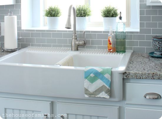 Ikea apron-front sink. $349. I like the cabinets, backsplash, and countertops too!