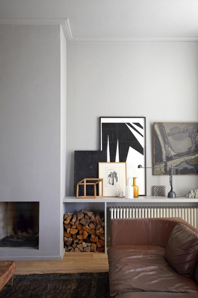 Installing a shelf over this rather large radiator turned an eyesore into a storage opportunity — and a fantastic place to show off art and objects.
