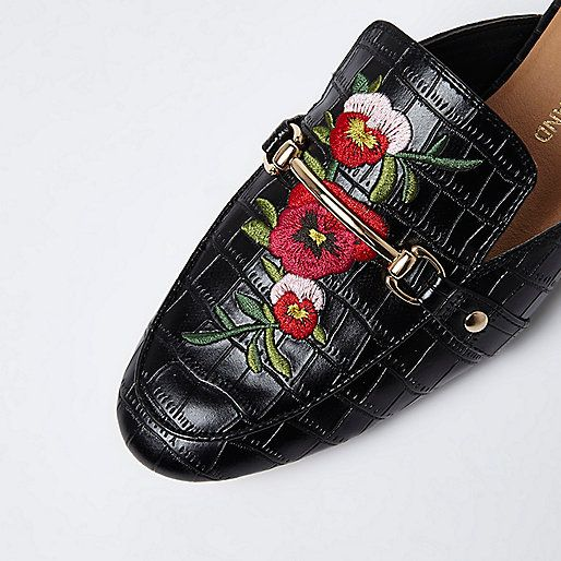 Faux leather croc effect upper Floral embroidery Snaffle detail Gold tone hardware Backless design Slip on style